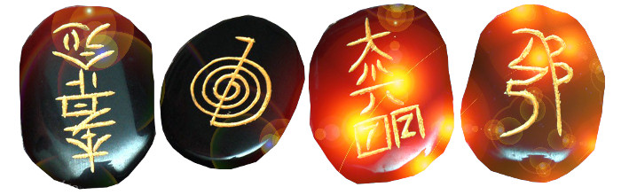 4 flat stones engraved with reiki symbols