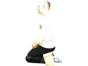 Kneeling meditation posture using a stool